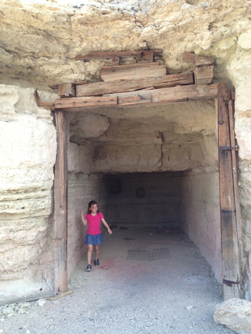 A little girl explores a cave home dug into the side of a hill by miners in the 1920s at a place called Dublin Gulch, just outside the town of Shoshone, Calif. (Henry Brean/Las Vegas Review-Journal)