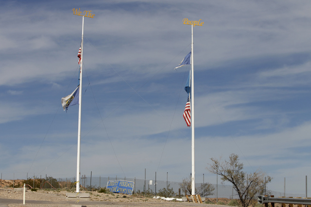 Flags and signs decorate the road leading to the ranch of Cliven Bundy near Bunkerville, Nev., Wednesday, Oct. 29, 2014. (Erik Verduzco/Las Vegas Review-Journal)