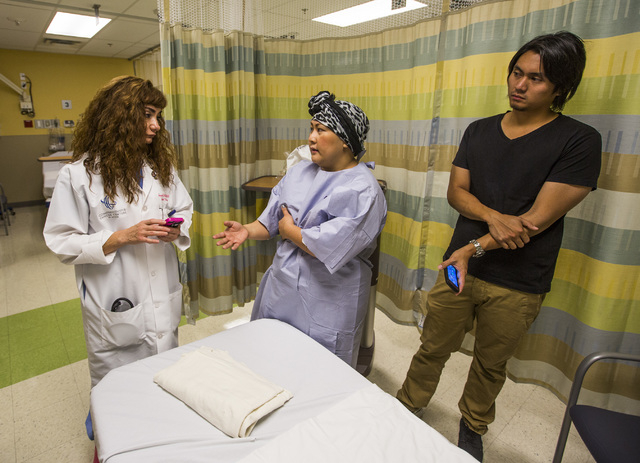 Dr. Souzan El-Eid, left, a breast surgeon with Comprehensive Cancer Centers talks to Nina Santos before she undergoes a double mastectomy at Summerlin Hospital on Thursday Oct. 22, 2014. On the ri ...