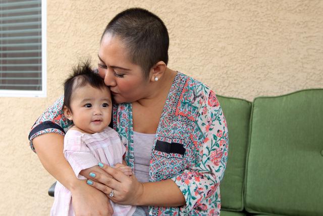 Nina Santos gives a little kiss to her daughter Olivia Santos Wednesday, Nov. 19, 2014.  (Sam Morris/Las Vegas Review-Journal)