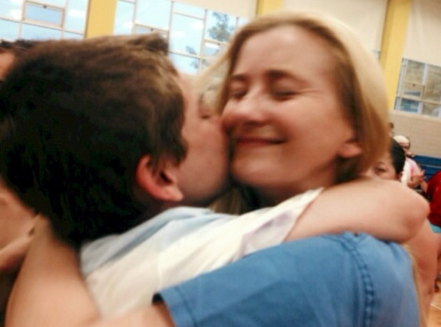 COURTESY Dennis Moore hugs his mother, Elizabeth Moore, at a parent event in Boston.