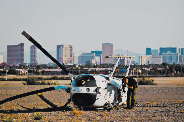 A Las Vegas police helicopter appeared to crash Monday, Sept. 24, 2012 at the North Las Vegas Airport, authorities said. Metropolitan Police Department spokeswoman Laura Meltzer said the landing o ...