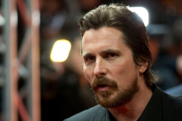 """Actor Christian Bale arrives on the red carpet for the film """"American Hustle"""" during the International Film Festival Berlinale in Berlin, Feb. 7, 2014. Bale has decided he won't play Steve Jobs in ..."""