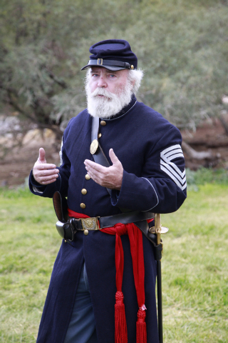 """Sargent Major Wilson (Jim Edwards) looks up while talking strategy right before the battle, at the ninth annual """"Civil War Days in the Battle Born State"""" event, Spring Mountain Ranch Sta ..."""