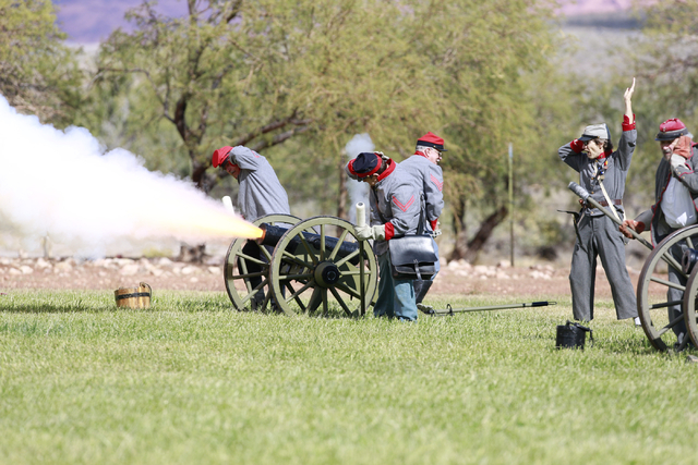 """One of three Confederate Artillery crews fires a cannon at the ninth annual """"Civil War Days in the Battle Born State"""" event, Spring Mountain Ranch State Park, Blue Diamond, Nevada on Sat ..."""