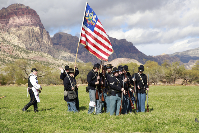 """Union troops make ready for battle followed by their medic in the white apron, at the ninth annual """"Civil War Days in the Battle Born State"""" event, Spring Mountain Ranch State Park, Blue ..."""