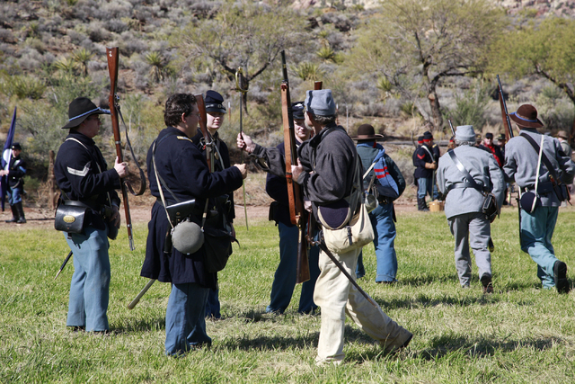 """Union troops surrender their rifles and a sword after being overrun by the Confederate troops, at the ninth annual """"Civil War Days in the Battle Born State"""" event, Spring Mountain Ranch  ..."""
