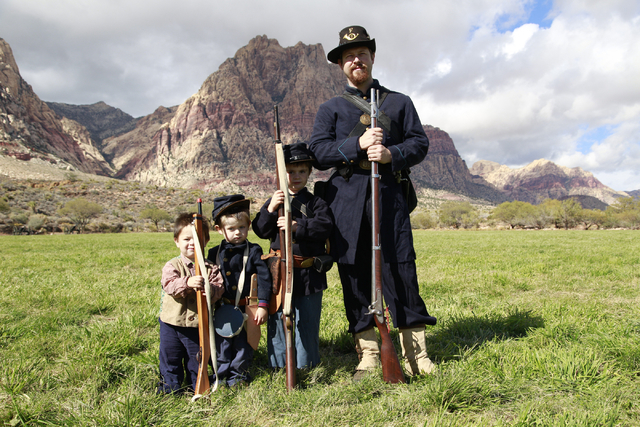 """Keith De Luca (father) poses after the battle with his sons Liam, Morgan and Joshua, at the ninth annual """"Civil War Days in the Battle Born State"""" event, Spring Mountain Ranch State Park ..."""