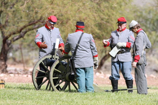 """Confederate artillery crew having a safety meeting prior to the battle, at the ninth annual """"Civil War Days in the Battle Born State"""" event, Spring Mountain Ranch State Park, Blue Diamon ..."""