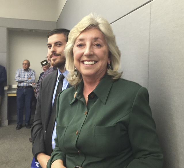 "Rep. Dina Titus, D-Nev., stands in the audience after speaking at the National Day of Remembrance ceremony Friday, Oct. 31, 2014, at the National Atomic Testing Museum. ""Too often your accomplishm ..."
