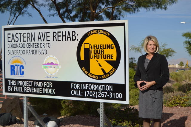 Tina Quigley, general manager of the Regional Transportation Commission, shows off a sign at St Rose Parkway and South Eastern Avenue that is being funded through the fuel tax indexing program.