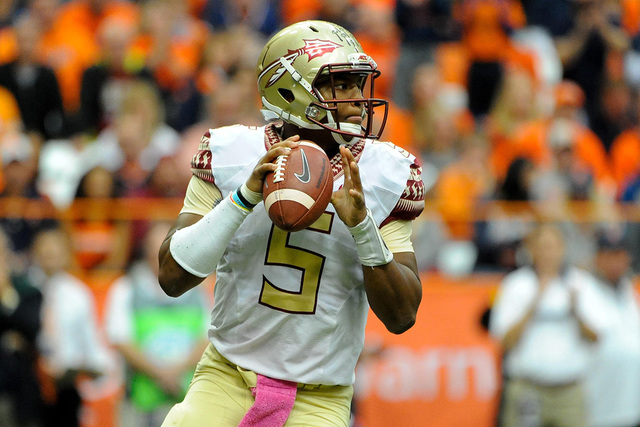 Oct 11, 2014; Syracuse, NY, USA; Florida State Seminoles quarterback Jameis Winston (5) drops back to pass against the Syracuse Orange during the second quarter at the Carrier Dome.  Florida State ...