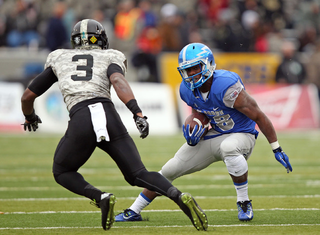 Air Force running back Jacobi Owens (28) cuts in front of Army defensive back Josh Jenkins (3) on Nov. 1, 2014, at Michie Stadium at West Point, N.Y. Owens, who went to Centennial High, ran for 11 ...