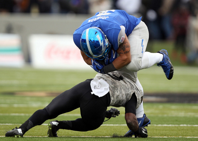 Air Force running back D.J. Johnson (3) is upended by Army defensive back Josh Jenkins (3) on Nov. 1, 2014, at Michie Stadium at West Point, N.Y.  The Falcons beat Army, 23-6, to win the Commander ...