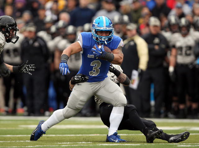 Air Force running back D.J. Johnson (3) is dragged down by an Army defender on Nov. 1, 2014, at Michie Stadium at West Point, N.Y.  The Falcons beat Army, 23-6, to win the Commander-in-Chief's Tro ...