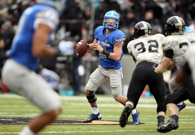 Air Force Falcons quarterback Kale Pearson (2) looks for room to pass against Army on Nov. 1, 2014, at Michie Stadium at West Point, N.Y. Pearson threw for 141 yards and two touchdowns in the vict ...