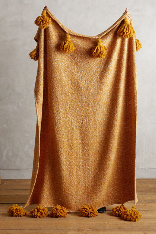 Courtesy Anthropologie Throws in fall colors, like this orange blanket from Anthropolgie, can warm up a room as the temperatures turn colder.