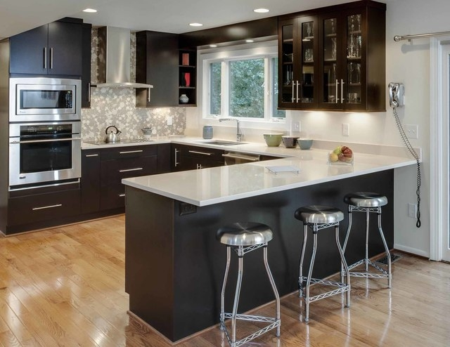 Michael Gullon/Phoenix Photography This 154-square-foot kitchen designed by Kitchen Encoungers of Annapolis, Md., features maple cabinets painted ebony.
