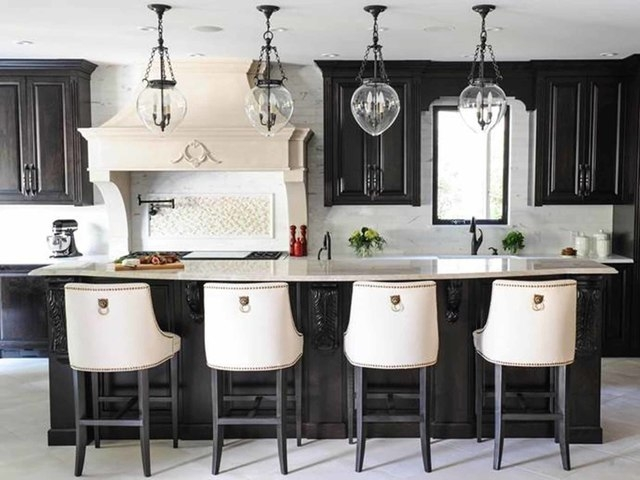 Tracey Ayton Photography A kitchen designed by Lianna Armstrong of Vancouver, B.C., has Caesarstone Pure White and Taj Mahal quartzite countertops.