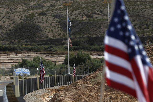 American flags decorate the road leading to the ranch of Cliven Bundy near Bunkerville, Nev., is seen on Wednesday, Oct. 29, 2014. (Erik Verduzco/Las Vegas Review-Journal)