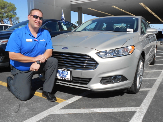 Courtesy photo Friendly Ford salesagent Chris Montalvo showcases the 2015 Ford Fusion, which has accounted for 35-40 percent of his sales in the last year.
