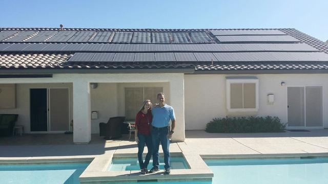 Courtesy photo Pictured are Danette and Stan Hyt at their Las Vegas home with a new AP Solar system, LED lighting and programmable thermostats.