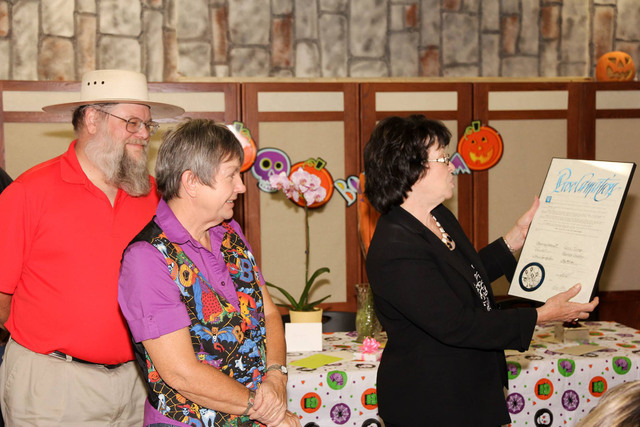 Clark County Commissioner Mary Beth Scow reads a proclamation honoring Dawna Joliff, center, for 38 years of service as a curator at the Clark County Museum. Museum administrator Mark Hall-Patton  ...