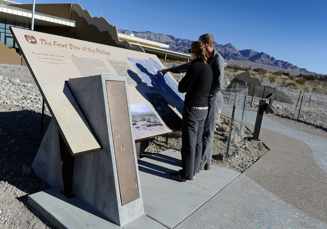 Marisa Peterson, left, and Brandon Lindsey examine one of the many information displays at the visitor center at the Desert National Wildlife Refuge. (David Becker/Las Vegas Review-Journal)