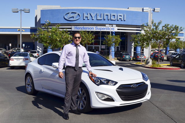 Courtesy photo Henderson Hyundai Superstore Salesperson Joe Rodriguez poses with his 2015 Genesis Coupe