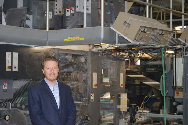 Allan Creel Jr., president of Creel Printing, stands in front of one of many presses at Creel Printing. (Stephanie Annis/Las Vegas Business Press)