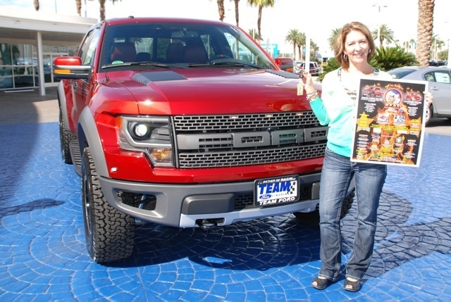 Courtesy photo Firefighter Linda Poe poses with her new 2014 Ford Raptor, won in a raffle to benefit Operation Fire H.E.A.T. and families of Southern Nevada.