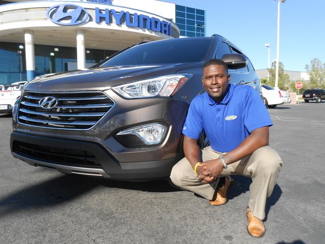 Courtesy Photo Planet Hyundai Sahara Sales Agent Eddie Echols Is Shown With  His 2014 Hyundai Santa