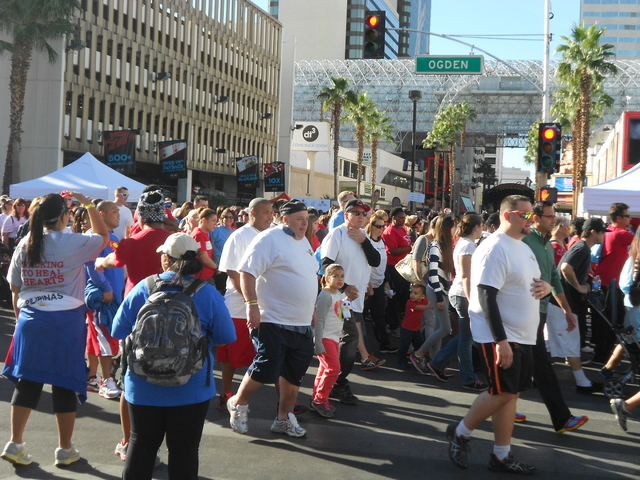 Courtesy photo A huge crowd begins its journey through downtown Las Vegas during the recent Heart and Stroke Walk/Run that raised more than $390,000 for the American Heart Association.