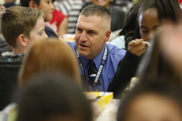 Lee Esplin, right, principal of Treem Elementary School, speaks with a student during lunch time at Treem Elementary School in Henderson Wednesday, Nov. 5, 2014.  Esplin was recently named Nevada  ...