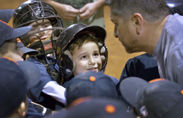 Matthew Martinez, center, listens as coach Eric Rodriguez gives a pep talk during a baseball game at the Arroyo Grande Sports Complex at 298 N. Arroyo Grande Blvd. in Henderson on Thursday, Nov. 1 ...