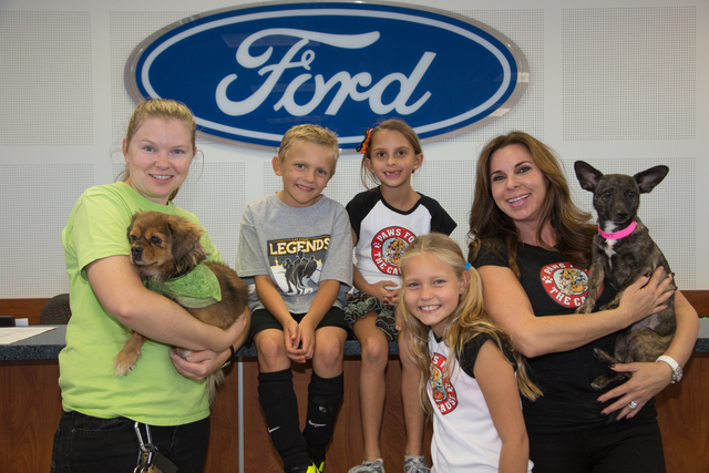 Courtesy Photo The fourth annual Fall Paws for the Cause was presented Saturday at Friendly Ford. Shown with event founder Dana Olliges-Arcana, right, are from left, Betsy VanDeusen, development m ...