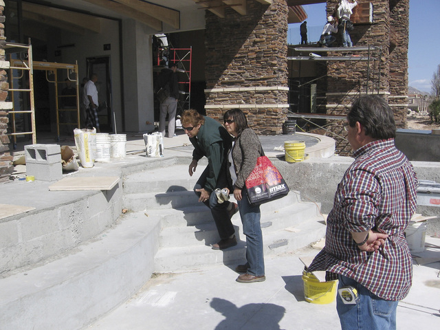 Dan Coletti of Sun West Custom Homes helps a customer with building their dream home.