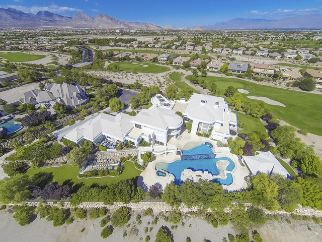Courtesy photo The tri-level, 22,000-square-foot home sits at the end of a tree-lined street on a cul-de-sac on a 2.5-acre lot in the hear of Queensridge. It is listed for $13 million.