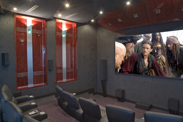 Courtesy photo With its three-tiered home theater outfitted with a dozen oversized black leather lounge chairs, surround sound and a 20-foot-screen big screen, the home theater must have made an i ...
