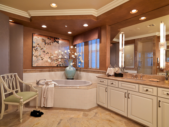 Courtesy photo Giallo Antico marble flooring and matching slab vanity tops are paired with white subway tile used as the tub-splash and shower enclosure create an elegant backdrop.  Asian touches  ...