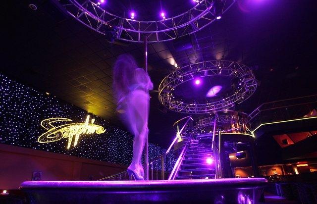 A dancer performs at Sapphire Gentlemen's Club in Las Vegas, June 23, 2004. (John Gurzinski/Las Vegas Review-Journal)