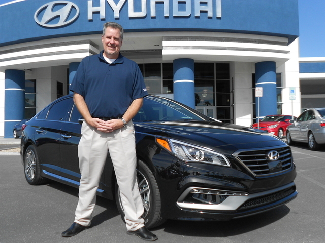 Courtesy photo Centennial Hyundai sales consultant TJ Saunders is now the owner of a 2015 Hyundai Sonata Sport 2.0T. The dealership is located at 6200 Centennial Center Blvd. in the northwest valley.
