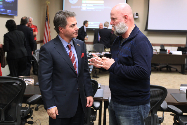Incoming UNLV president Len Jessup speaks speaks with regent James Dean Leavitt after accepting a contract offer from the Nevada System of Higher Education during a meeting of the Board of Regents ...