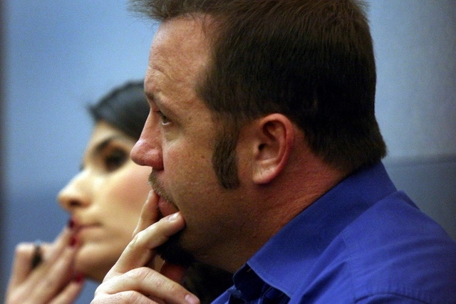 Defendant Robert Chiodini, right, and his attorney Paola Armeni sit in a courtroom at the Regional Justice Center on Wednesday Dec. 21, 2011 during a county grand jury indictment.  (Jeff Scheid/La ...