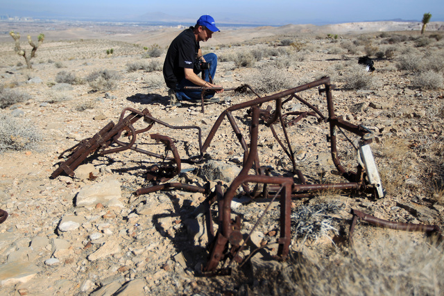 Doug Scroggins looks over wreckage at the crash site of Bonanza Flight 114 about 15 miles southwest of McCarran International Airport Thursday, Nov. 13, 2014. (Sam Morris/Las Vegas Review-Journal)