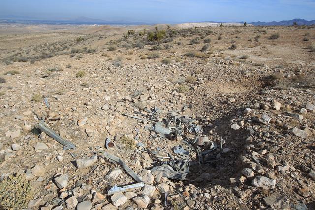 A pile of debris is seen at the crash site of Bonanza Flight 114 about 15 miles southwest of McCarran International Airport Thursday, Nov. 13, 2014. (Sam Morris/Las Vegas Review-Journal)