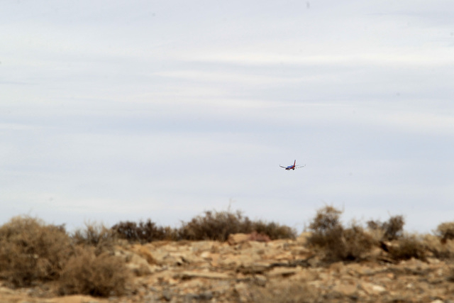 A Southwest Airlines jet is seen from the crash site of Bonanza Flight 114 as it makes its approach to McCarran International Airport Thursday, Nov. 13, 2014. (Sam Morris/Las Vegas Review-Journal)