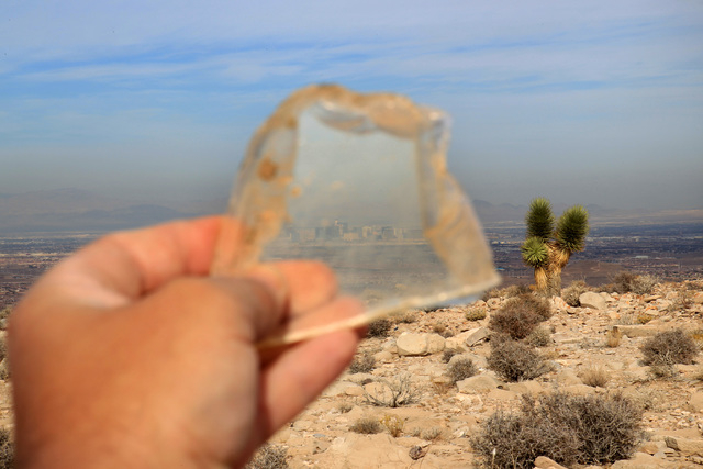The Strip is seen through a piece of broken window at the crash site of Bonanza Flight 114 about 15 miles southwest of McCarran International Airport Thursday, Nov. 13, 2014. (Sam Morris/Las Vegas ...
