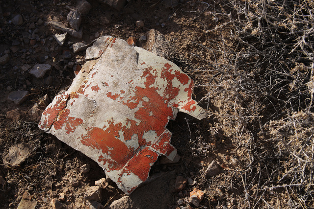 A piece of wreckage in Bonanza's orange color scheme is seen at the crash site of Bonanza Flight 114 about 15 miles southwest of McCarran International Airport Thursday, Nov. 13, 2014. (Sam Morris ...