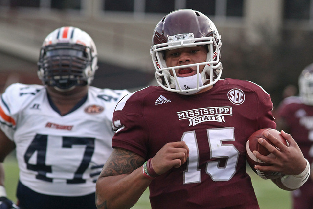 Mississippi State quarterback Dak Prescott (15) sprints into the end zone for a touchdown ahead of UT-Martin defender Deantae Glover (47) during the first half of an NCAA college football game in  ...